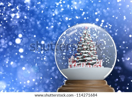 snow globe with red decorated christmas tree and presents inside on a blue winter defocused background, clipping path and copy space. - stock photo