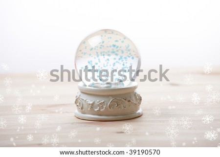 Snow globe with snow flakes, beautiful ornament - stock photo