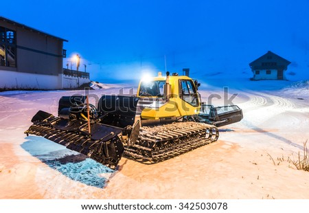 Snow Groomers when remove a snow at night time when ski resort close.