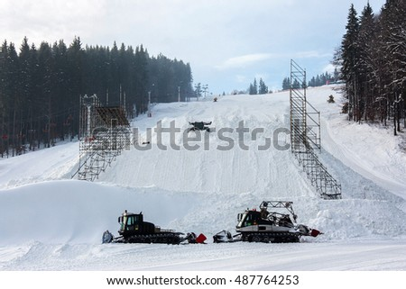 Snow-grooming machine on snow hill ready for skiing slope preparations in Ukrainian Carpathian