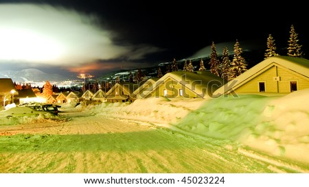 Snow houses in a row in ski resort panoramic, sweden - stock photo