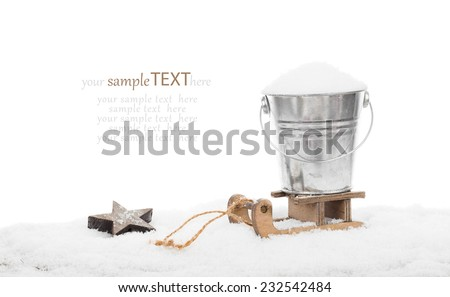 Snow in a bucket on a sled, isolated over white background, with copyspace for your greeting - stock photo
