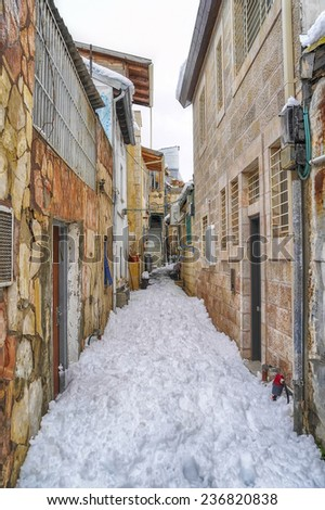 Snow in Jerusalem, narrow streets of Nahlaot residential district - stock photo