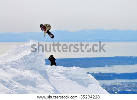 Snow Jumper and Photographer - stock photo