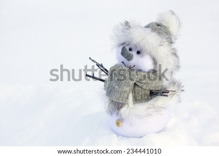 snow man toy standing close up - stock photo