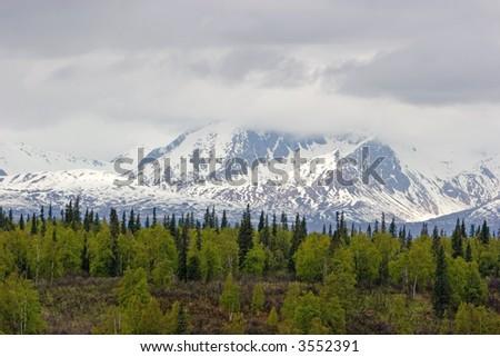 Snow melting on mountains in Alaska Range - stock photo