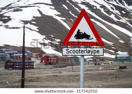 Snow mobile warning sign in Longyearbyen, Svalbard, Norway - stock photo