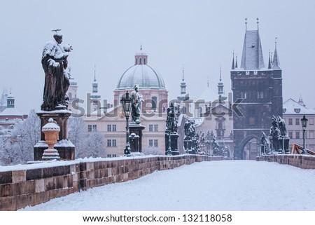 snow morning at Charles bridge in winter, Prague, Czech Republic - stock photo