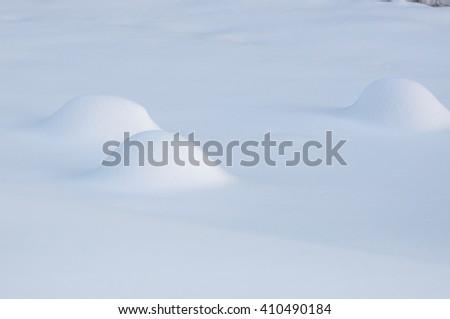 Snow mounds - stock photo