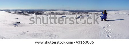 Snow mountain blue sky panorama taking by photographer