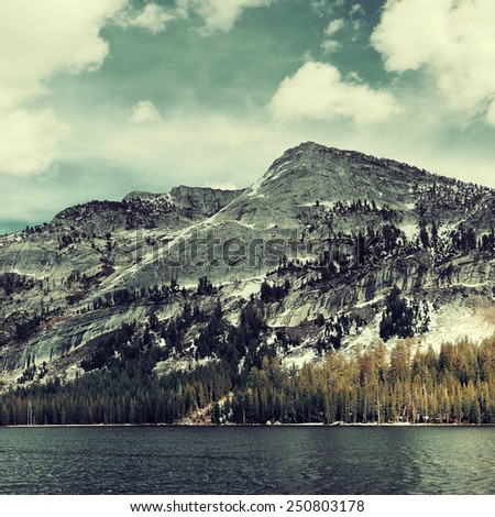 Snow mountain cloud and lake with reflections in Yosemite. - stock photo