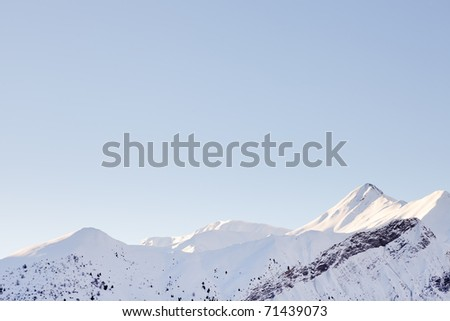 Snow mountain landscape with blue sky. Sunshine. Peaks. Rocks. Alps. France. - stock photo