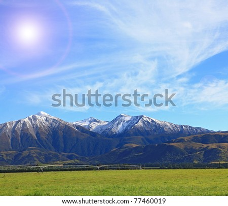 snow mountain of southern alpine alps in New Zealand with sun - stock photo