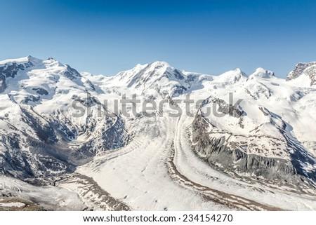 Snow Mountain Range Landscape with Blue Sky, Alps, Switzerland - stock photo