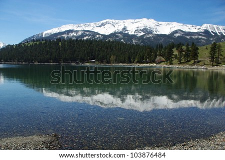 Snow mountain reflection on clear waters of Wallowa Lake, Oregon