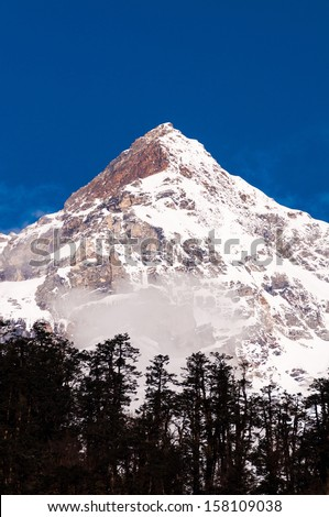 Snow mountain with blue sky at Sikkim , India - stock photo