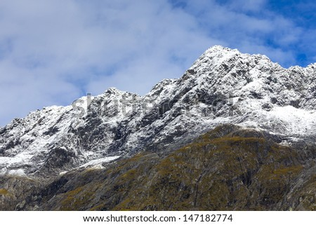Snow mountains along Milford Sound road New Zealand