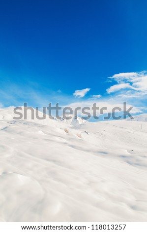 Snow mountains on bright winter day