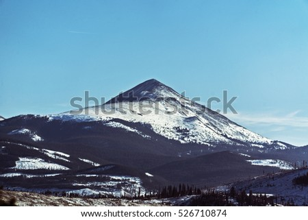 Snow Mountains with Blue Skies