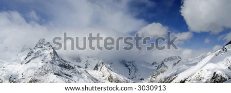 snow mountains with clouds