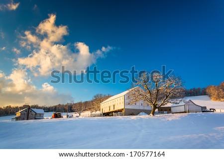 Snow on a farm in rural York County, Pennsylvania. - stock photo