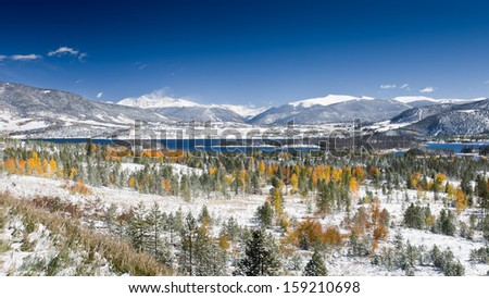 Snow on Aspen Trees and Lake Dillon in Summit County, Colorado with View of Fourteen-Thousand Foot Peaks - including Torreys Peak and Grays Peak, the Highest Peak on the Continental Divide - stock photo