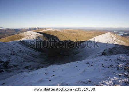 snow on mountain tops at sunset helvellyn, cumbria