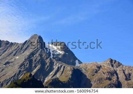 Snow on Rocky Mountain Peaks, New Zealand - stock photo