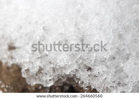 snow on the ground. close-up - stock photo