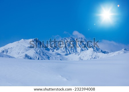 Snow plateau landscape and high mountain rocky peaks in Andorra - stock photo