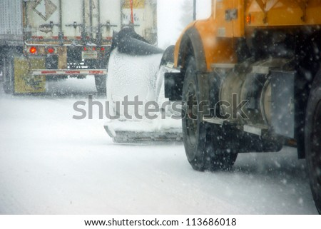 Snow plows keep the road open  during winter storm in Eastern Oregon - stock photo