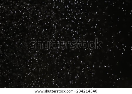 snow rain on a black background texture overlay - stock photo
