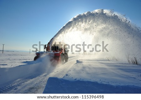 snow removal cleaning road - stock photo