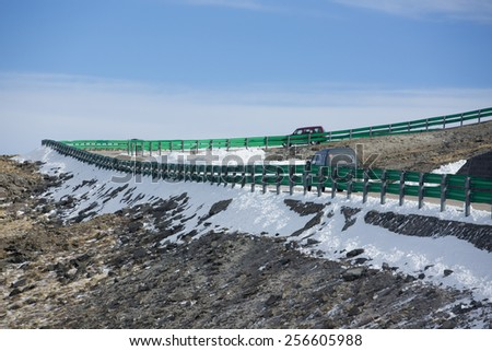 snow road slope in mountain area - stock photo