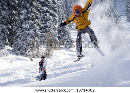 Snow Skier Jumping in winter forest at mountains Tien Shan - stock photo