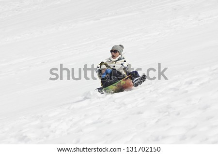 Snow sledding Crash - stock photo