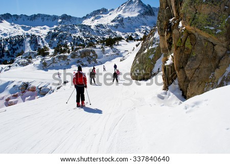 Snow slope in mountain with small slopes for beginners. Ski resort in Alps, Andorra. Outdoor sport and activity. Landscape with hill in Pyrenees good for children. - stock photo