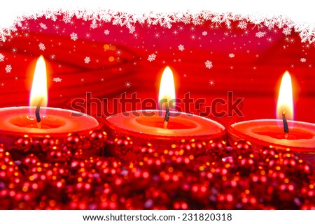 Snow star over red candle