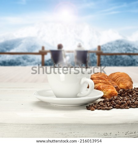 snow sun desk and coffee  - stock photo