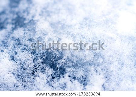 Snow texture macro. Shallow depth of field.  - stock photo