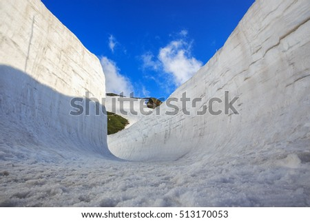 Snow wall at Kurobe alpine in Japan with blue sky