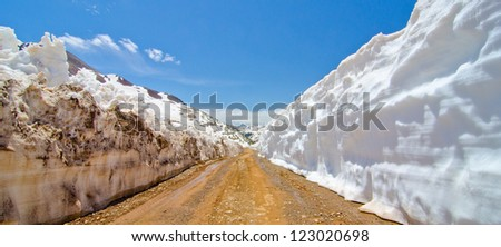 Snow Wall Leading from Animas Forks to Cinnamon Pass in the San Juan Mountains in Colorado - stock photo