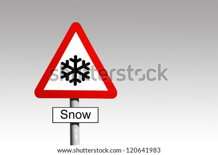 Snow Warning triangle road sign against a grey sky