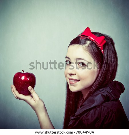 Snow White with an apple - stock photo