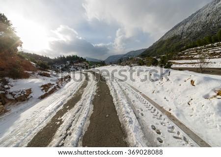 Snow winding road - stock photo