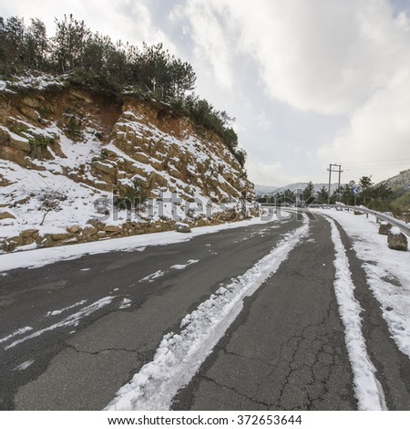 Snow winding road - stock photo