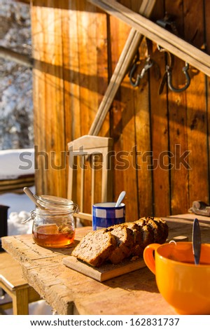 Snow winter cottage breakfast on wooden table