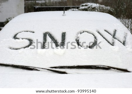 Snow with snow flakes on car screen - stock photo