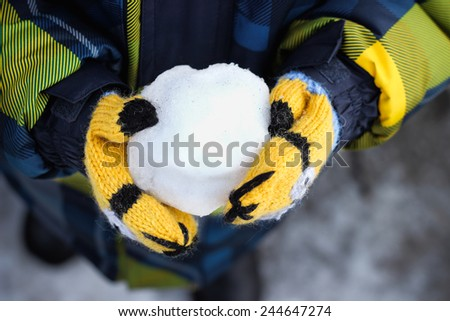 snowball in hand - stock photo