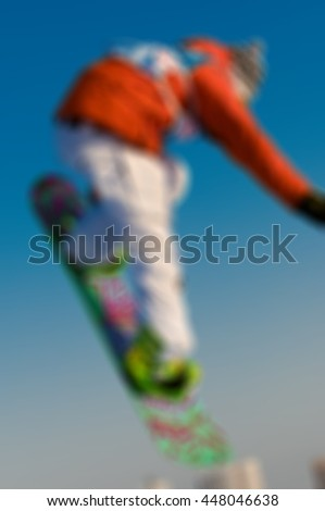 Snowboard action theme creative abstract blur background with bokeh effect - stock photo